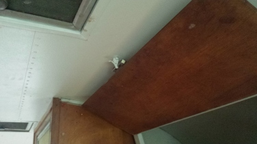 the latch into the ceiling
